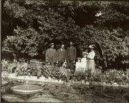 Family standing behind some giant floating lily pads. Como Park St. Paul, Minnesota? EW Carter photo ca. 1900 Glass negative: 10″x8″