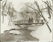 A frozen Minnehaha Falls Minneapolis, Minnesota Two women in winter. EW Carter photo ca. 1900 Glass negative: 10″x8″