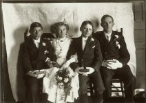Three boys and a girl seated inside all dressed up in white gloves. EW Carter photo ca. 1900 Glass negative: 7″x5″