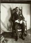 All dressed up in white gloves seated young man. EW Carter photo ca. 1900 Glass negative: 5″x7″