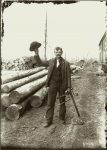 A standing lumberman with tools. EW Carter photo ca. 1900 Glass negative: 5″x7″
