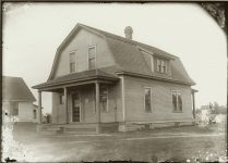 A wood framed house with an outhouse out back. Note the boy near the outhouse EW Carter photo ca. 1900 Glass negative: 7″x5″