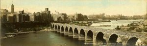 "#817 Stone Arch Bridge, Milling District Minneapolis, MINN F. L. Wright Photo copyright 1907 11""x3.5"" Hand-colored Real Photo Post Card"