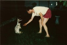 Brian trying to lure the escaped Jackalope South Minneapolis Sunday night May 31, 1992, An escaped Jackalope from our trip to the Black Hills of South Dakota in the 1951 Studebaker Champion.Snapshot: 6″x4″
