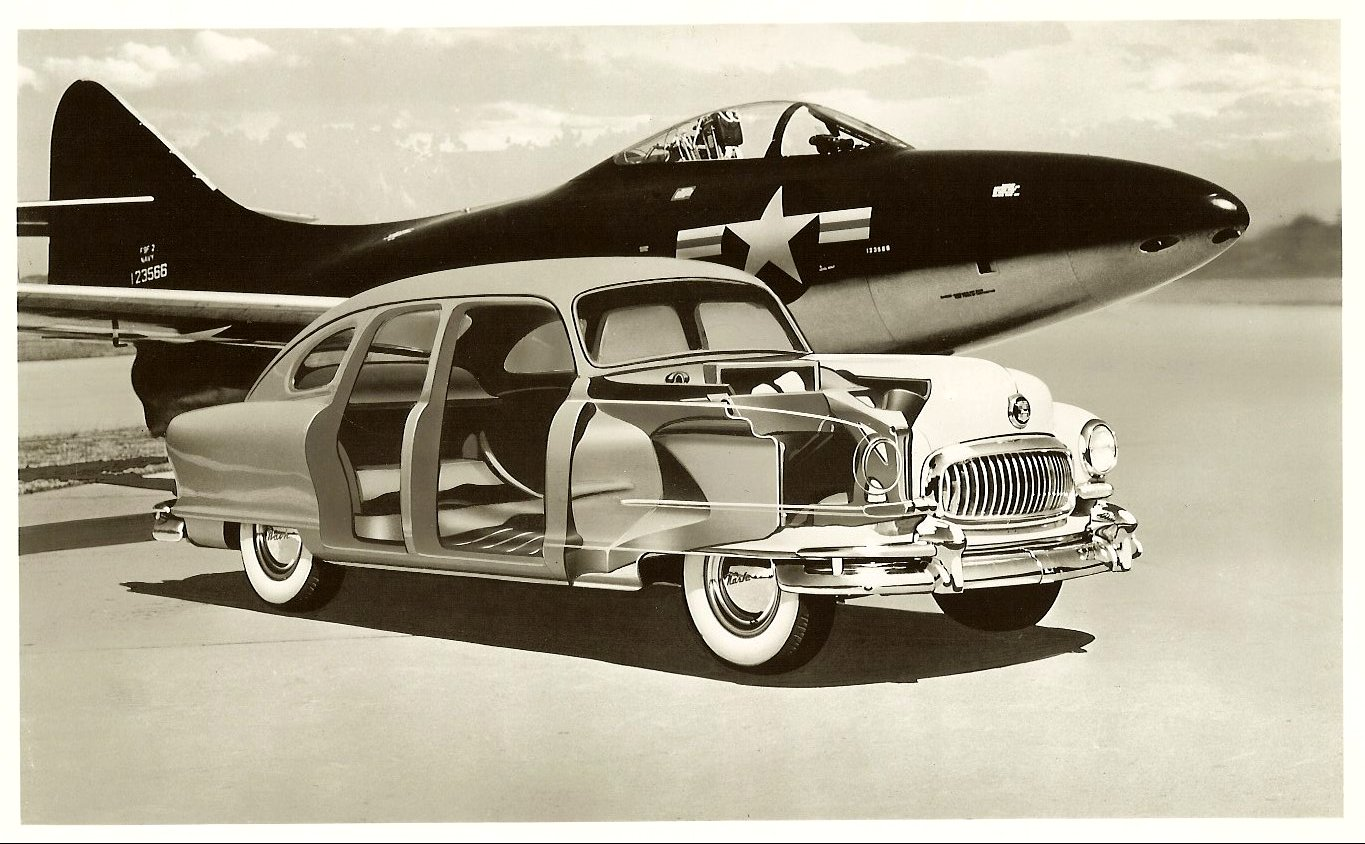 1951 NASH Cut-away view of a 4-door NASH next to a jet fighter airplane. 8″x10″ Black & White photograph
