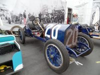 "2014 8 16 1911 NATIONAL 40 Racer No. 20 ""T' Head, 4-cyl, 460 cu. In. – 100 h. p. (est.) Driven by Charlie Merz and Mechanician Leo E. Banks in 1911 Indianapolis 500 1911 7th Place Winner HMSA Monterey Historics Mazda Raceway Laguna Seca, CAL ca. August 16, 2014 Driver's side view"