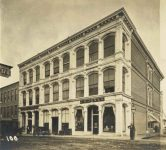 100 – Corner Cedar and Third Streets, 1875. First Iron Front Building Photographs of Early St. Paul From Edward A Bromley's Collection Published ca. 1910 5'5″x3.5″ Postcard