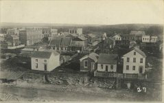 27 – 1857 – Toward corner Cedar and Fourth Streets Photographs of Early St. Paul From Edward A Bromley's Collection Published ca. 1910 5'5″x3.5″ Postcard