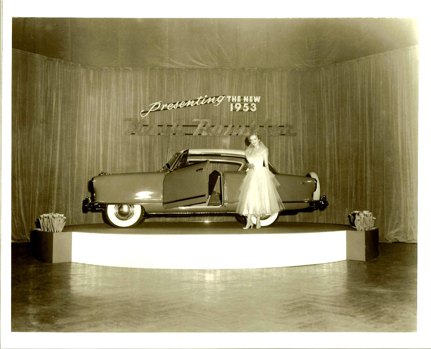 Presenting the New 1953 Nash Rambler Big party in a ballroom From a 10″x8″ Black & White negative
