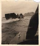 "1945 2 ""—– of our boats returning from the beach at Iwo Jima. Mt. Suribachi in background Feb. 1945"" Battle: 19 February – 26 March 1945 Martin J. Ward USS Lenawee APA-195 2.75""x3"" snapshot"