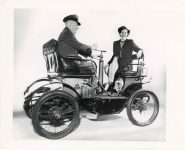 1898 3-WHEELER James J. Kelly and Betty Pause try out the French DeDion auto made in 1898 10″×8″ front