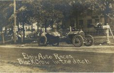 1910 Elgin Auto Races Black Crow Stinson in the ditch RPPC front