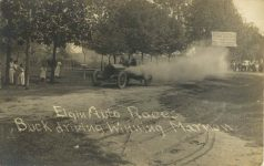 1910 Elgin Auto Races Buck driving Winning Marmon Kane County Trophy RPPC front 1
