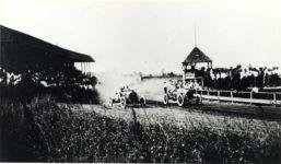 1912 ca. race cars on track