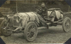 1912 ca. STUDEBAKER race car with a National sweatered driver RPPC front