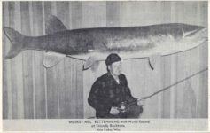 "1950 ca. ""MUSKEY MEL"" RETTENMUND with World Record at Friendly Buckhorn, Rice Lake, Wis. postcard front"
