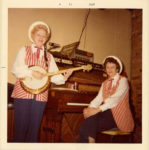 1955 ca. Fern Dale, born 1917 and friend at Shakey's Pizza snapshot 3.5″×3.5″
