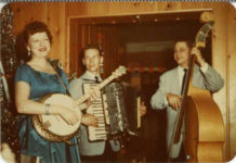 1955 ca. Fern Dale, born 1917 on banjo snapshot 2.75″×2″ front