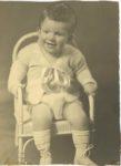1935 ca. Cute seated little boy 5.25″×7.25″