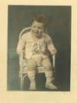 1935 ca. Cute seated little boy color C. H. Wiebuer photo 7.5″×10.25″