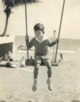 1937 ca. Cute boy on swing on beach 7.5″×9.5″