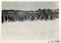 1911 NATIONAL Jacksonville Races Five National racecars lined up in front of fence photo Burton Historical Collection Detroit Public Library