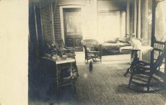 1900 ca. Cats on chair and table porch RPPC front