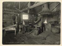 1912 Colbroth Co. Camp No. 4 blacksmith shop interior Roleff photo 8.5″×6.5″